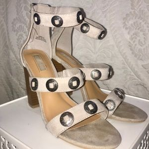 grey suede heels with tarnished silver accents